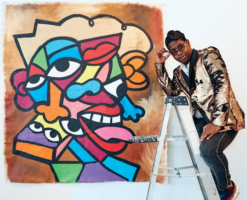 Turner poses in front of his abstract mural at Camilo Pardo's studio in Detroit.