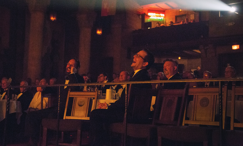 Audience members clad in tuxedos