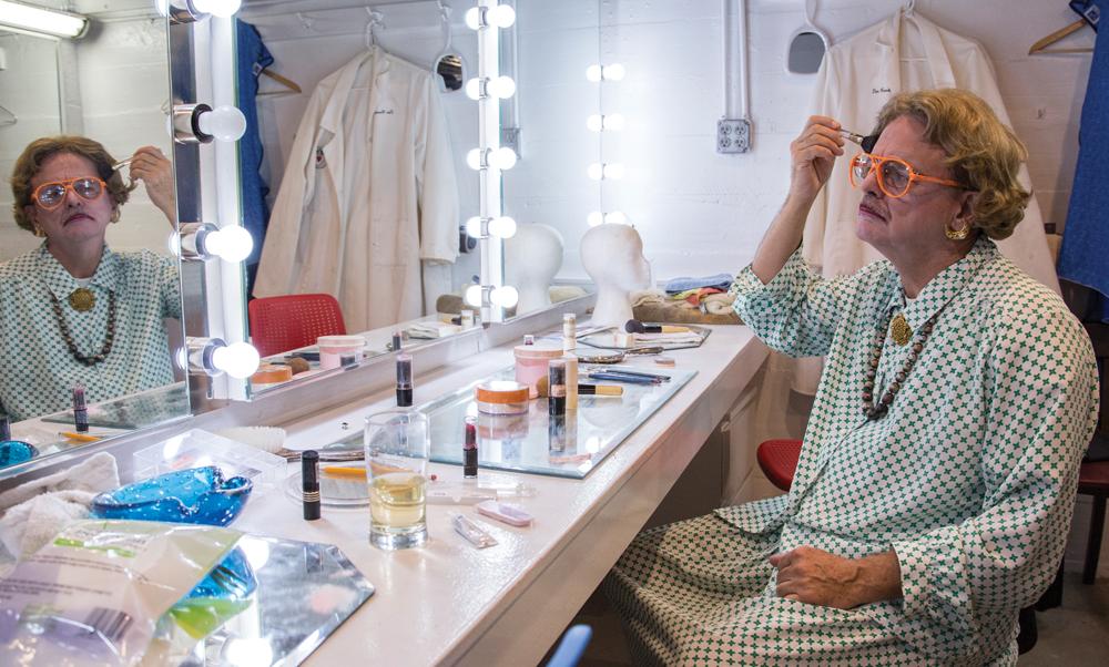 The Players member Michael Dixon applies makeup.