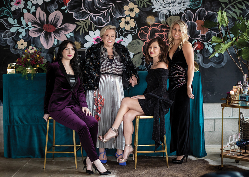 From left: Eileen Martin in an Escada jacket and pants; Candice Simons in a Dries Van Noten jacket, Theory blouse, and Marc Jacobs skirt; Lauren Van Haaren in a Redemption dress; and Allie Jagger in a Balmain dress. All pictured at the Brooklyn Outdoor loft. To inquire about renting the space, visit brooklynoutdoor.com.